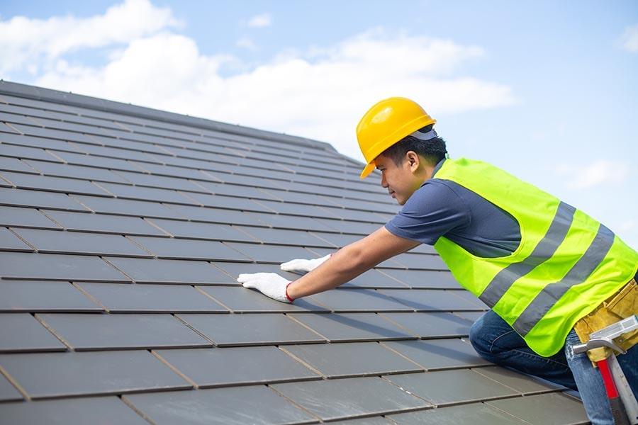 waterproofing contractor performing roof works